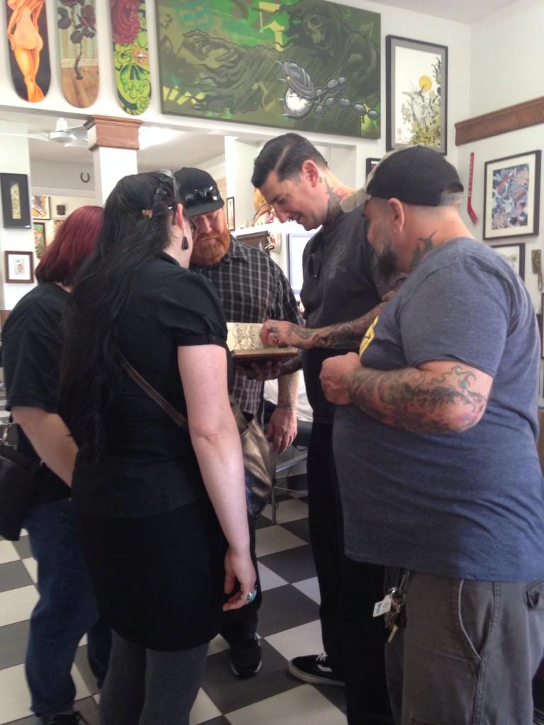 Artist huddle at TattooMania