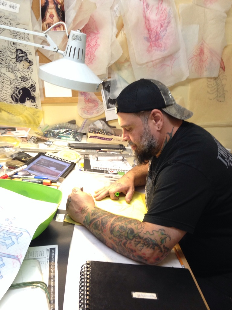 The Bossman at work-- our business The Hand of Fate Tattoo in Ithaca, NY.
